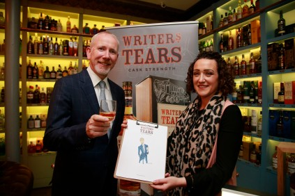 19/10/2017 - Walsh Whiskey Launch at L. Mulligan's Whiskey Shop at the Powerscourt Centre. Pictured were Bernard and Illustrator Linda. Photograph Nick Bradshaw